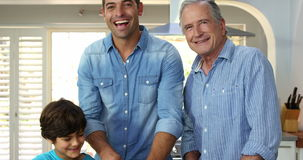 Multi generation men of the family are cooking. In the kitchen stock footage