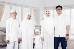 Multi-generation muslim family portrait at home