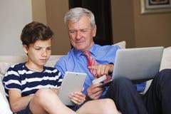 Multi generation shopping online Royalty Free Stock Photos
