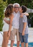Multi-generational family, great-grandfather, great-grandson and great-granddaughter royalty free stock image