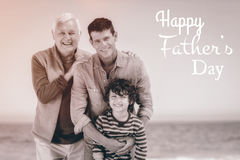 Multi generational family with Happy fathers day. Happy fathers day against photograph of family stock photography