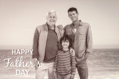 Multi generational family with Happy fathers day. Happy fathers day against photograph of family stock photos