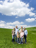 Multi-generational family standing in field Royalty Free Stock Image
