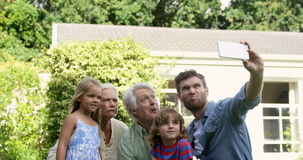Multi-generational family taking a funny picture