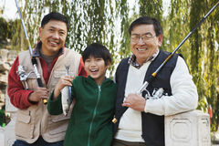 Multi-generational men fishing portrait Stock Images