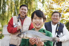 Multi-generational men fishing portrait Stock Photography