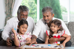 Multi generations family playing games stock photography
