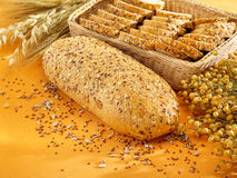 Multi-grain bread and wheat on table Royalty Free Stock Photos
