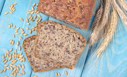 Multi-grain bread on a wooden background. Healthy food concept. royalty free stock photo