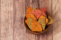 Multi Grain Flax Seed Tortilla Chips. Some Multi Grain Flax Seed Tortilla Chips In A Wooden Bowl Stock Photos
