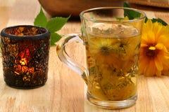 Multi-herbal sunny tea. Freshly infused cup of herbal tea. Healthy drink afternoon Royalty Free Stock Photos