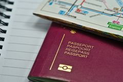 Multi-language biometric passport ready for traveling royalty free stock photos