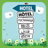 Multi language hotel signpost Stock Image