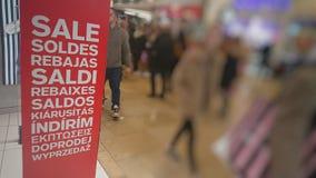 Multi Language Shop Sale Sign. Eleven languages Red sale sign stock photos