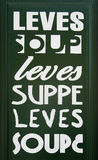 Lets have a soup!. Soup written in different languages on a green board Royalty Free Stock Photos