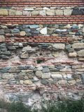 Multi layer wall at Histria Citadel. Constanta county, Romania. Some type of materials used to build it, from brute rocks to brick royalty free stock photography