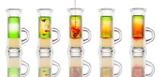 Multi-layered alcohol shot isolated on white Royalty Free Stock Photo