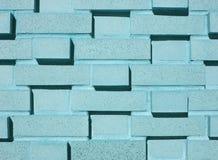 Multi-Layered Aqua Brick Wall. A pastel blue, teal or aqua multi-layered and multi-sized brick wall Stock Photo