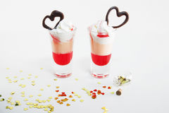 Multi-layered cocktail shot, close-up. Saint valentine`s day. Royalty Free Stock Photo