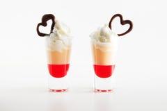 Multi-layered cocktail shot, close-up. Saint valentine`s day. Stock Image