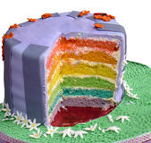 Multi layered rainbow cake. Slice cut out of rainbow cake to show colours and layers Stock Photo