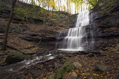 Multi-level waterfall. Waterfall with 3 levels falling into a canyon. Taken with a very wide angle lens with long exposure time Stock Images