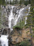 Multi-level Waterfall in Jasper National Park. With multiple streams of water running down the face of the mountain stock photography