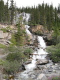 Multi-level Waterfall in Jasper National Park. With multiple streams of water running down the face of the mountain stock images