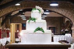 Multi level white wedding cake stock photo
