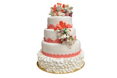 A multi level white wedding cake with pink flowers on top Stock Photos
