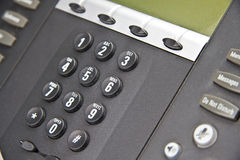 Multi-Line Phone System. A new black multi-line phone system Stock Photo