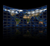 Multi media screens displaying the atlas Royalty Free Stock Photography
