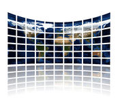 Multi media screens displaying the atlas Stock Photo
