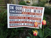 Multi Message Protest Sign. Photo of complicated multi message protest sign in a washington dc neighborhood during april in spring on 4/16/19 stock photo