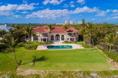 Multi million dollar home in Boynton Beach FL. Aerial drone image of a mansion in Boynton Beach FL USA blue sky palm trees Stock Photography
