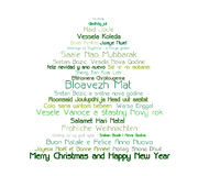 Multi-national Christmas tree. Christmas tree full of wishes of Merry Christmas and Happy New Year in many languages Stock Images