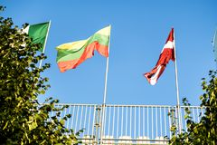 Multi national flags of different countries against the blue sky royalty free stock photography