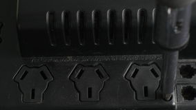 Multi outlet power strip unscrewing. Close up of a multi outlet power strip unscrewing and inside look stock video