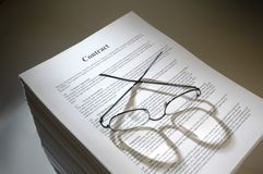 Multi-page legal contract agreement. A pile of papers representing a multi-page legal contract royalty free stock photos