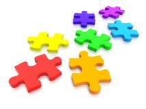 Multi pezzi colorati del puzzle Fotografie Stock