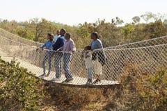 Multi ponte de corda do cruzamento da família da geração junto Imagem de Stock