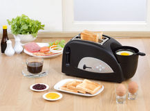 Multi purpose bread toaster. It has function for boiling and frying egg also Stock Photo