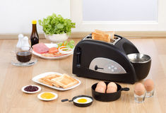Multi purpose bread toaster. It has function for boiling and frying egg also Stock Images