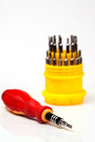 Multi-purpose screwdriver. A red multi-purpose screwdriver isolated from white background Royalty Free Stock Photos