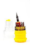 Multi-purpose screwdriver. A red multi-purpose screwdriver isolated from white background Royalty Free Stock Images