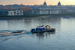 Multi purpose vessel working on the River Thames and passng Greenwich University. Bright winter& x27;s afternoon shot of this working vessel travelling up the royalty free stock image