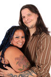 Multi race couple. Happy diverse multi race couple smiling and holding eachother on a white background stock photography