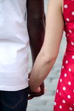 Multi race young couple in holding hands in Old Town Royalty Free Stock Photo