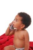 Multi-racial baby die in een deken wordt verpakt Stock Foto's