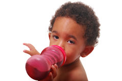 Multi-racial baby drinking Royalty Free Stock Photo
